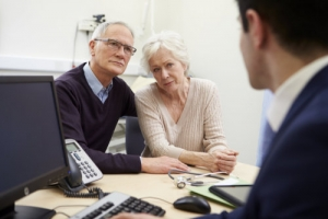 elderly couple meeting with consultant